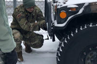 New York Air National Guard Master Sgt. Peyton Knippel, assigned to the 174th Attack Wing, prepares a Humvee for a snow storm response mission at Hancock Field Air National Guard Base in Syracuse, N.Y. on Jan. 18. The New York National Guard alerted 450 airmen and soldiers for possible missions as a major snow storm approaches New York. (Air National Guard photo/Barbara Olney)
