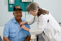 A doctor uses a stethoscope to listen to the heart of a Vietnam Veteran (Photo: va.gov)