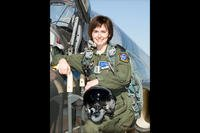 Maj. Devon Meister with her aircraft