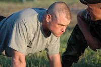 Sgt. David M. Knotts Jr, concentrates on his form during the push-up portion of the Army Physical Fitness Test.