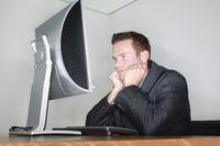Civilian man in a suit with a computer