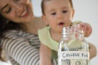 Mom and baby with college fund jar