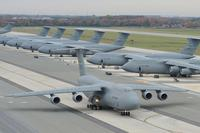 A C-5M Super Galaxy aircraft taxis with other C-5Ms in the background Nov. 2, 2015, at Dover Air Force Base, Delaware. (U.S. Air Force photo/Greg L. Davis)