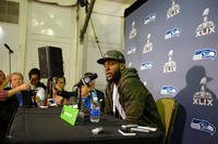 Kam Chancellor, a defensive back for the National Football League's defending champion Seattle Seahawks, talks to members of the media during Super Bowl Week in Glendale, Ariz., Jan. 26, 2015. DoD photo by Army Sgt. 1st Class Tyrone C. Marshall Jr.
