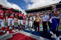 Army Maj. Gen. Roger Mathews, U.S. Army Pacific deputy commander, looks on during the ceremonial coin toss at the 2012 NFL Pro Bowl game at Aloha Stadium in Honolulu, Hawaii. (U.S. Air Force Tech. Sgt. Michael R. Holzworth)