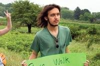 In this July 26, 2012 photo provided by the Northumberland News, Alexander Ciccolo participates in a peace walk through Brighton, Ontario.(Dave Fraser/Northumberland News via AP)