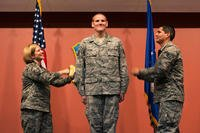 Master Sgt. Tanya Hubbard and Staff Sgt. Roberto Davila tack staff sergeant stripes onto Spencer Stone during a promotion ceremony at Travis Air Force Base, Calif., Oct. 30, 2015. (U.S. Air Force photo/T.C. Perkins Jr.)