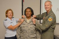 Cynethia Sheppard was promoted to the rank of Major on August 16, 2008. Pinning her is Lt. Col. Jody Jondo (left) and Brig. Gen. Guy Walsh (right). (U.S. Air Force photo by TSgt. Chris Schepers)