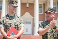 Marine Corps Brig. Gen Austin E. Renforth, the commanding general of Marine Corps Recruit Depot Parris Island and Eastern Recruiting Region, applauds Cpl. Miles Hogan during a ceremony at Parris Island, Aug. 24, 2017. (U.S. Marine Corps/Joseph Jacob)