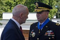 Minister of National Defense, Antoni Macierewicz thanked the Commanding General of U.S. Army Europe, Lt. Gen. Ben Hodges for his service during the 97th anniversary of the Battle of Warsaw Aug. 15, 2017, in Warsaw, Poland. (U.S. Army/Sgt. Justin Geiger)