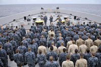 Sailors and Marines on the USS Green Bay during an all-hands call