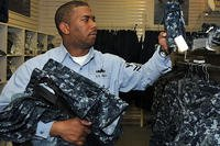 Navy sailor shopping for uniforms.