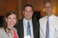 Angela Wilson, a Defense Department teacher in Vicenza, Italy, poses with her husband, Chase, and U.S. Education Secretary Arne Duncan during National Teacher of the Year events April 23, 2012, in Washington, D.C. Wilson was among four finalists.
