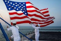 Sailors assigned to the color guard aboard the aircraft carrier USS Dwight D. Eisenhower (CVN 69) retire the colors (U.S. Navy/Mass Communication Specialist 2nd Class Andrew J. Sneeringer.)