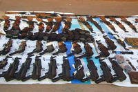 42 weapons recovered by Mexican military in Naco, Sonora, Mexico. Weapons were investigated by U.S. ICE. (U.S. Dept. of Justice photo)