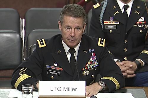 Army Lt. Gen. Austin S. Miller testifies before the Senate Armed Services Committee in Washington during a hearing to review his nomination as the next Resolute Support mission commander and commander of U.S. Forces-Afghanistan, June 19, 2018. His son, Army 2nd Lt. Austin Miller, sits behind him. (Screengrab from DVIDS Video)