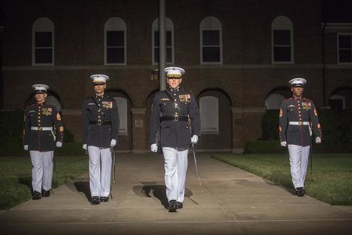 Marines with the Marine Barracks Washington D.C. parade marching staff march down Center Walk during a Friday Evening Parade at Marine Barracks Washington D.C., May 11, 2018. (Marine Corps/Cpl. Robert Knapp)