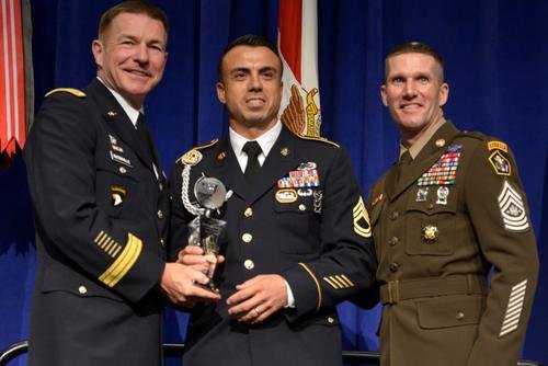 Sergeant Major of the Army Daniel Dailey (far right) wears a version of new Army Green uniform at the 2018 Association of the United States Army's Annual Meeting and Exposition. (U.S. Army)