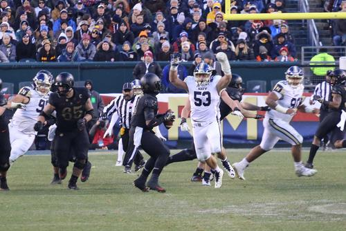 Army quarterback Kelvin Hopkins Jr. attempts a pass against Navy's defense in the annual Army-Navy game on Dec. 8, 2018. (Military.com photo)