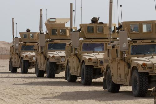 Soldiers line up their Humvees before a vehicle gunnery exercise at Camp Buehring, Kuwait, on Nov. 16, 2015. The U.S. Army's Mobile Protected Firepower system, coming online in 2025, will provide enhanced firepower capable of destroying hardened targets. (U.S. Army/Sgt. Youtoy Martin)