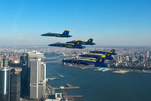 The U.S. Navy Flight Demonstration Squadron, the Blue Angels, pilots fly in the world-renowned Delta Formation past the New York skyline, Dec. 13, 2013. (U.S. Navy photo/Mass Communication Specialist 1st Class Terrence Siren)