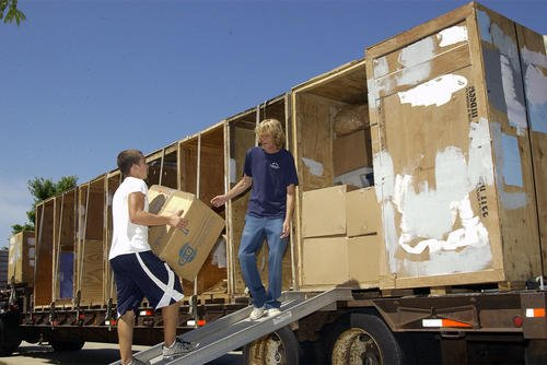 Movers at Scott Air Force Base, Illinois, load up a truck with household goods. Jose Ramirez/Air Force